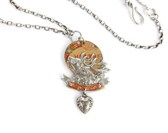 Dear Hart — vintage deer badge and riveted tin assemblage necklace with sterling heart and clover charms
