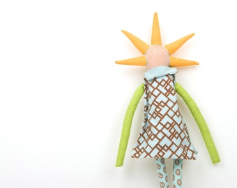 Modern rag doll ,ooak art doll -  funky handmade Peach doll with orange spikes haircut , Wearing geometric dress shades of baby blue, green