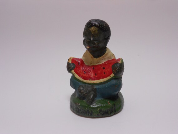 black boy watermellon paperweight This is a cast iron paper weightthe paperweight is in shape of a boy eating a bisque figurines kids #watermellon # black americana black boy eating.