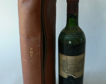 Vintage leather wine carrier from Diz Has Neat Stuff