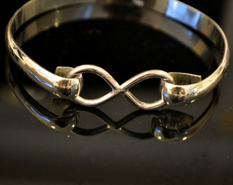 "Sterling silver infinity bangle bracelet.  ""Forever"""