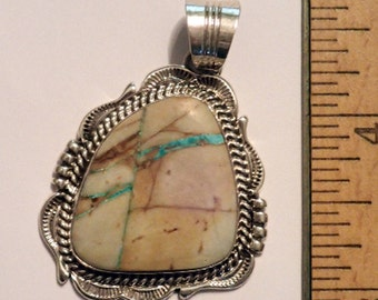 Boulder Turquoise Pendant in Sterling Silver.