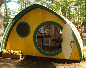 Large Hobbit Hole Playhouse Kit: outdoor wooden kids clubhouse with round front door and windows, made to order