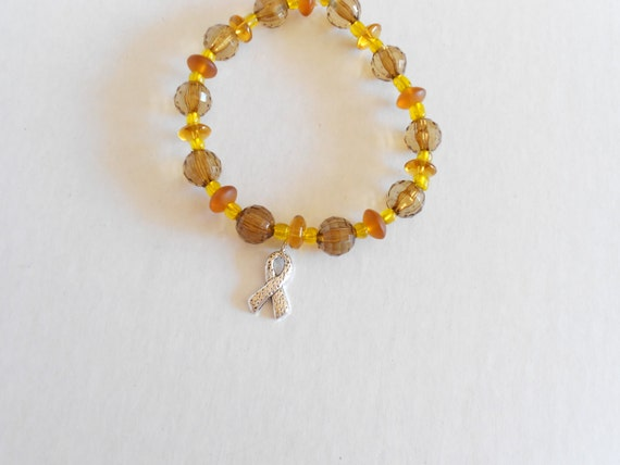childhood cancer awareness gold beaded bracelet by dtailsulike