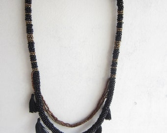Black, Gold, Bead and Tassel Necklace.