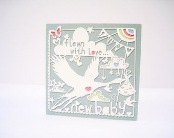New baby papercut style pink/blue boy/girl square greeting card.