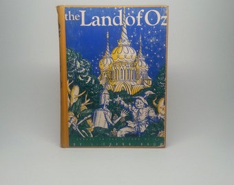 The Land of Oz by L. Frank Baum Published by The Reilly & Lee Company Hardcover Book
