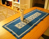 Vintage blue table runner with white embroidered motifs