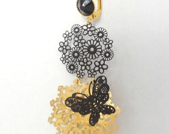 Filigree gold earrings with pendant.