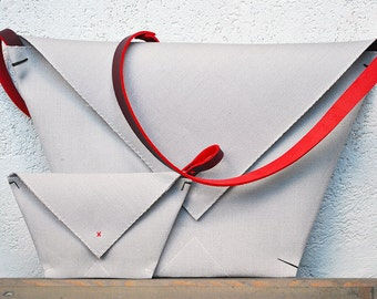 Envelope clutch and matching envelope purse in gray with red strap, origami double