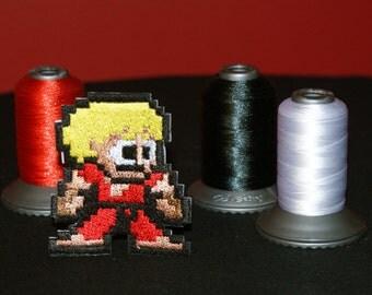 Pixel art Street Fighter Ken Shiny Metallic Embroidery Iron On patch.