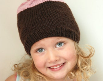 Merino Wool Hat with pompom for a child, hand knitted in Brown and pink and a small gakure