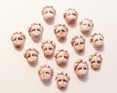 7 cabochons boy grumpy face HM ceramic rustic sepia porcelain steam punk supply DIY