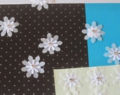 a dozen upcycled 3D vintage-style white parchment flower stickers with gem