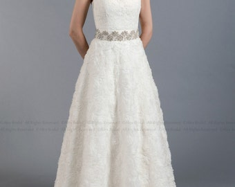 Lace wedding dress, wedding dress, bridal gown, strapless alencon lace with rosette skirt.