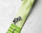 "Dog lover necktie. Mens  tie. Animal friend tie.""Walking the Pipeline Dog"" necktie with green stripes and crazy dog."