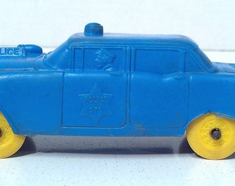 Vintage 1960s Auburn Rubber Police Car - Blue with Yellow Wheels