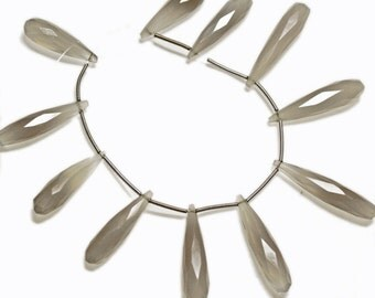Elongated grey chalcedony faceted teardrops. Approx: 7x35mm - 8.5x36mm.  Select a quantity.