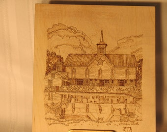 Stable and lake front pyrographic art.
