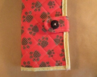 Red and brown puppy paw print passport cover