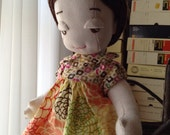 A little cloth doll named Olivia is on sale