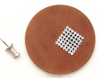 Swarovski leather circle with embedded diamanté