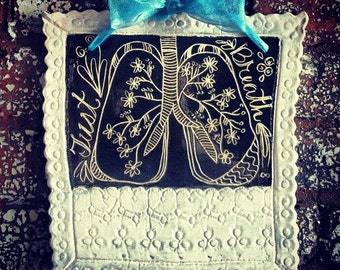 Sgraffito Just Breathe Floral Lungs and Pressed Eyelet Lace into Clay Wall Hanging Art