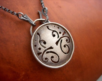 Sterling Silver Hand Cut Tiny Circle Necklace.
