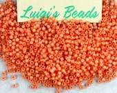11/0 Round TOHO Japanese Glass Seed Beads #2112-Silver-Lined Milky Grapefruit 15g