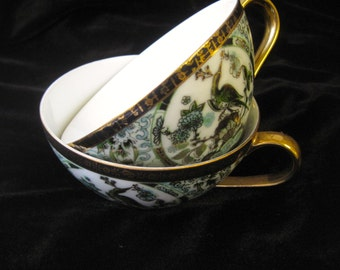 Vintage green gold black floral and peacock motif Japanese tea cups