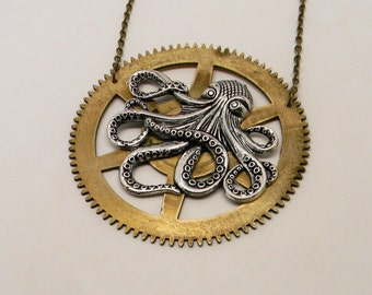 Steampunk octopus necklace mounted on large gear.