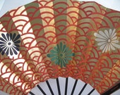 Wave Pattern Gold and Orange Fan with Green, Blue, and White Flower Motifs