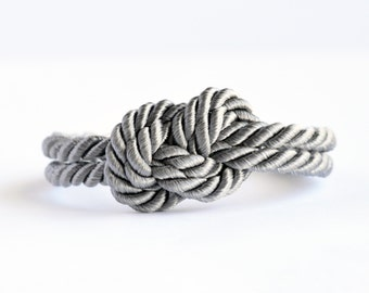 Shiny fog gray infinity knot nautical rope bracelet with silver anchor charm