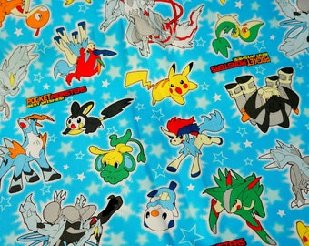 "Pokemon Fabric pokemon and stars fat quarter 50 cm by 106 cm or 19.6"" by 42"""