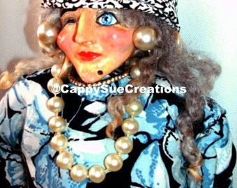 Broad with attitude doll