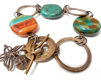 Teal Green and Rust Ceramic and Vintaj Brass Charm Bracelet, Textured, Geometric, Glazed Clay, Bee & Sun Charms, Circles and Rings