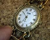 1928 brand Fancy Bracelet Watch - enamel design.
