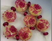 a set of 7 delicate raised floral button or spree handmade lampwork beads in alabaster ivory and fuchsia - Le Jardin