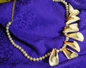 SALE ITEM.  Exotic shells on pearl strand