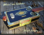 Mighty fine Delta style cigar box slide guitar