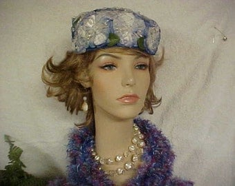 Very nice blue flower fascinator pill box hat- fits 22 inches