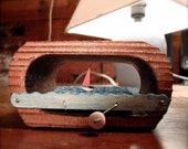 sailboat automaton in upcycled wooden box