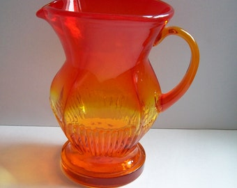 Mid century amberina glass pitcher yellow and orange glass vase