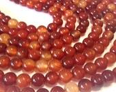 "Carnelian 6mm round beads full 14"" stand."