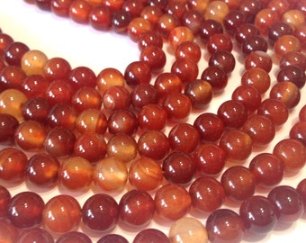 "Carnelian 6mm round beads full 14"" stand."