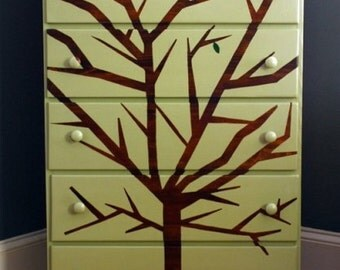 Painted dresser with tree