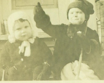 Toddlers in Winter Boy Girl Bundled Up For Cold Sitting on Front Porch Antique Vintage Black White Photo Photograph