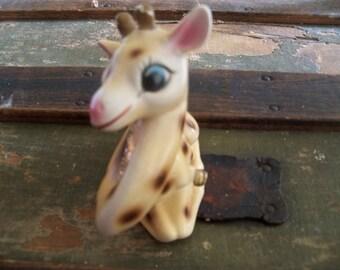 the lone widow spotted giraffe  large salt shaker