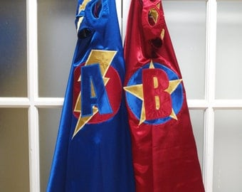 Custom Superhero Cape, Superhero Mask, and a pair of Superhero Cuffs.
