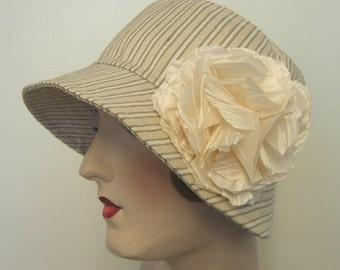Sale.Trina Cloche in French silk stripe with large flower pin.